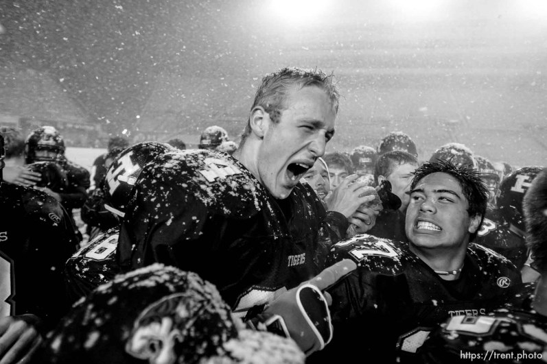 Trent Nelson | The Salt Lake Tribune Hurricane's Colton Marshall, left, shares a yell with teammate Joseph Takau after Hurricane defeated Desert Hills 21-0 in the 3A State Championship high school football game at Rice-Eccles Stadium in Salt Lake City, Utah, Friday, November 18, 2011.