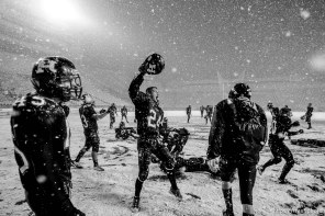 Trent Nelson | The Salt Lake Tribune Hurricane's Tyson Long (24) and teammates celebrate in the snow after they defeated Desert Hills 21-0 in the 3A State Championship high school football game at Rice-Eccles Stadium in Salt Lake City, Utah, Friday, November 18, 2011.