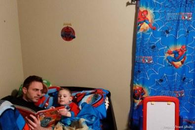 Trent Nelson | The Salt Lake Tribune Daniel Comer reads a bedtime story to his fiancé's son, T.J. Carver, Thursday, March 29, 2012 in Ogden, Utah.