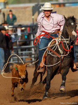 Trent Nelson | The Salt Lake Tribune Keaton Newman in the tie down competition at the Utah High School Rodeo Finals Saturday, June 9, 2012 in Heber City, Utah.