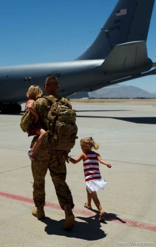 Trent Nelson | The Salt Lake Tribune First Lieutenant Patrick Barrington walks with his daughters Amelia, left, and Rachel as the soldiers from the Utah Army National Guard's Second Battalion, 211th Aviation unit returned from a 12-month deployment to Afghanistan, Saturday, June 23, 2012 in Salt Lake City, Utah.