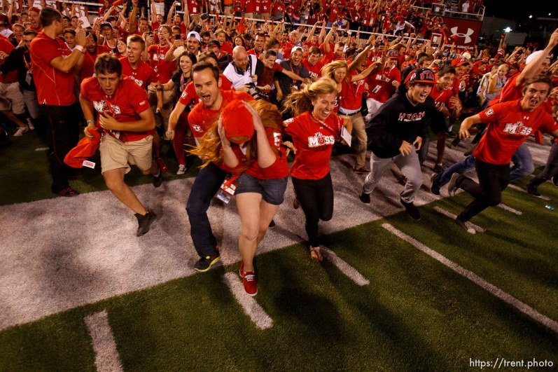 Trent Nelson | The Salt Lake Tribune Utah fans swarm onto the field to celebrate the win, but it's not over yet, as Utah hosts BYU college football in Salt Lake City, Utah, Saturday, September 15, 2012.