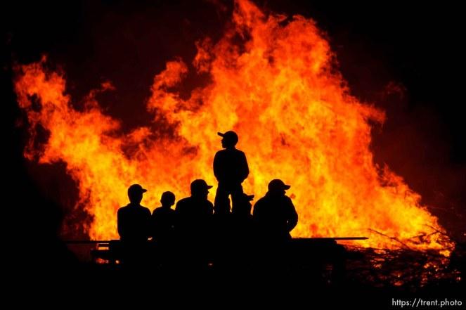 FLDS young men and boys watching a bonfire, Thursday November 29, 2012.