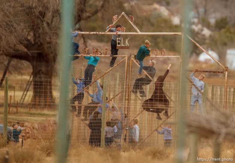 Trent Nelson | The Salt Lake Tribune Children climbing a fence at what was once a thriving community zoo, Friday November 30, 2012 in Hildale.