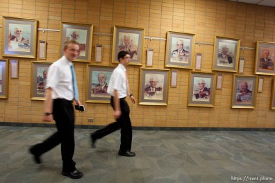 Trent Nelson   The Salt Lake Tribune Missionaries walk past portraits of church leaders at the Missionary Training Center of the Church of Jesus Christ of Latter-day Saints in Provo Tuesday June 18, 2013.