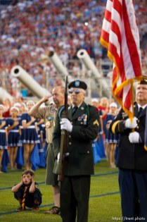 Trent Nelson | The Salt Lake Tribune Presentation of the colors at the Stadium of Fire Thursday July 4, 2013 in Provo. Andrew Wright covers his ears from loud fireworks