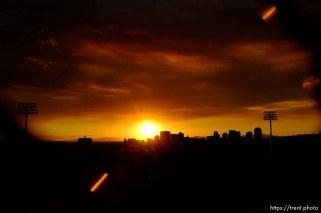 Trent Nelson | The Salt Lake Tribune The sun sets over a smoky Salt Lake City skyline Sunday August 11, 2013.