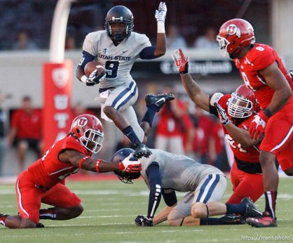 Trent Nelson | The Salt Lake Tribune Utah State Aggies wide receiver Bruce Natson (9) leaps into the air as the University of Utah hosts Utah State, college football Thursday, August 29, 2013 at Rice-Eccles Stadium in Salt Lake City.