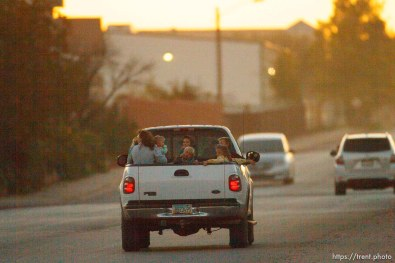 Trent Nelson | The Salt Lake Tribune kids in the back of a truck in Hildale , Sunday, October 6, 2013.