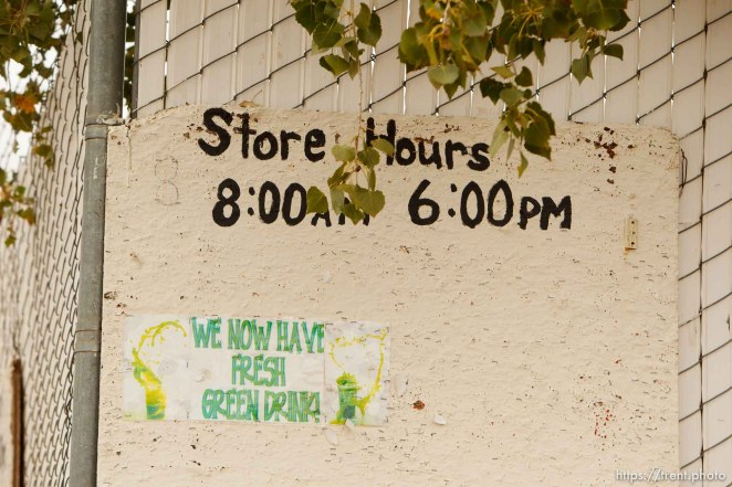 Trent Nelson | The Salt Lake Tribune store hours sign, we now have fresh green drink, in Colorado City Thursday, October 10, 2013.