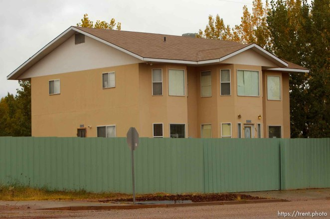 Trent Nelson | The Salt Lake Tribune home with green fence in Colorado City Thursday, October 10, 2013.