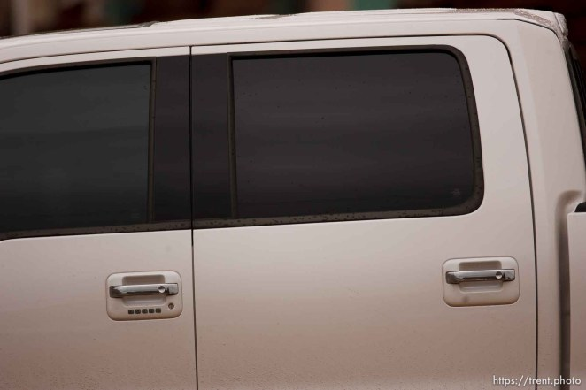 Trent Nelson | The Salt Lake Tribune tinted window truck that pulled up to observe me near bishop's storehouse in Colorado City Thursday, October 10, 2013. possibly church security