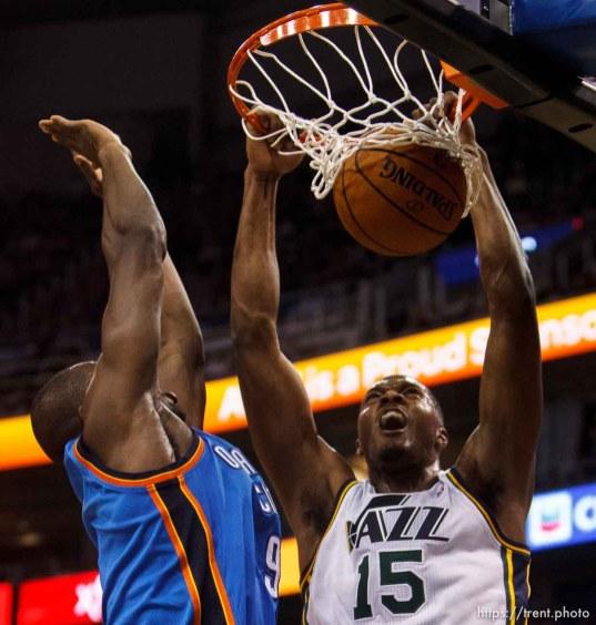 Trent Nelson | The Salt Lake Tribune Utah Jazz forward Derrick Favors (15) dunks the ball, as the Utah Jazz host the Oklahoma City Thunder, NBA Basketball at EnergySolutions Arena in Salt Lake City, Wednesday October 30, 2013.