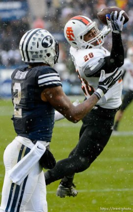 Trent Nelson | The Salt Lake Tribune Idaho State Bengals defensive back Cameron Gupton (28) intercepts a pass intended for Brigham Young Cougars wide receiver Cody Hoffman (2), as BYU hosts Idaho State, college football at LaVell Edwards Stadium in Provo, Saturday November 16, 2013.