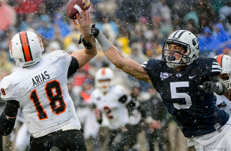 Trent Nelson | The Salt Lake Tribune Brigham Young Cougars linebacker Alani Fua (5) gets a hand on a pass by Idaho State Bengals quarterback Justin Arias (18), which was returned for a touchdown by Brigham Young Cougars defensive lineman Bronson Kaufusi (90) as BYU hosts Idaho State, college football at LaVell Edwards Stadium in Provo, Saturday November 16, 2013.
