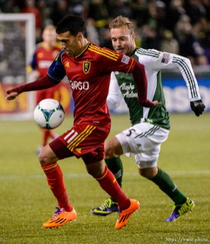 Trent Nelson | The Salt Lake Tribune Real Salt Lake's Javier Morales (11), with Portland's Michael Harrington (5) defending, as Real Salt Lake faces the Portland Timbers, MLS soccer Sunday November 24, 2013 in Portland.