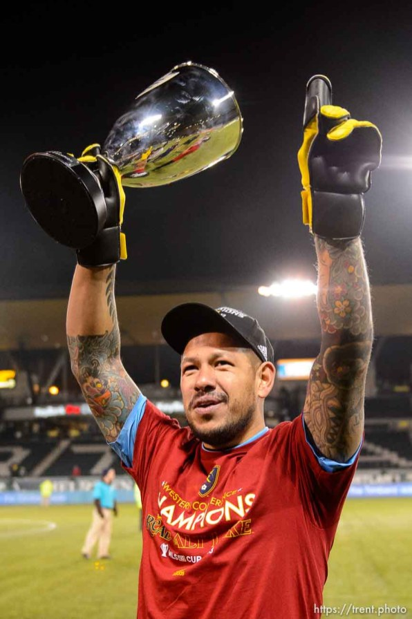 Trent Nelson | The Salt Lake Tribune Real Salt Lake's Nick Rimando (18) holds aloft the trophy after Real Salt Lake defeated the Portland Timbers, MLS soccer Sunday November 24, 2013 in Portland.