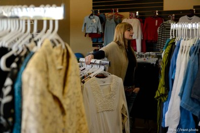 Trent Nelson | The Salt Lake Tribune Ruth Olson looks over donations for a planned thrift store at the community center in Colorado City that is being set up by Holding Out Hope, Saturday December 14, 2013.