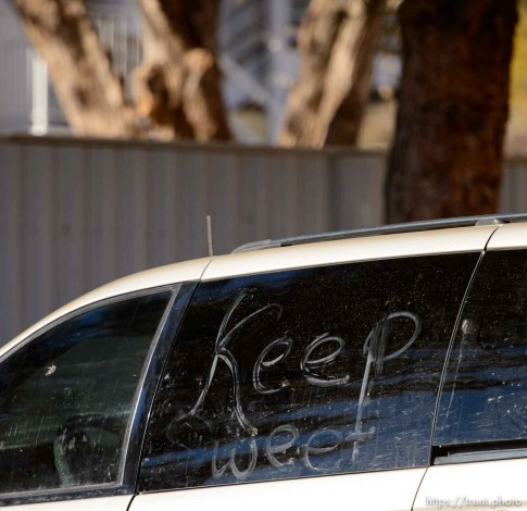 Trent Nelson   The Salt Lake Tribune Keep Sweet, a common FLDS phrase, written on a van in Hildale Sunday December 15, 2013.