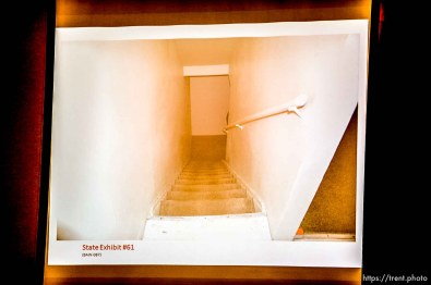 Trent Nelson | The Salt Lake Tribune A photo showing the stairs leading to the basement of the apartment where Hser Ner Noo was found, displayed during the murder trial of Esar Met in Salt Lake City, Tuesday January 7, 2014. Met is accused of killing 7-year-old Hser Ner Moo in 2008