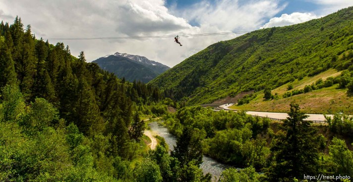 Trent Nelson | The Salt Lake Tribune Benjamin Bolton takes a ride above Provo Canyon at Max Zipline, Saturday May 31, 2014.
