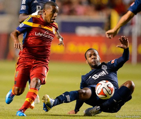 Trent Nelson | The Salt Lake Tribune Real Salt Lake's Joao Plata (8) loses the ball to Vancouver's Carlyle Mitchell (24), as Real Salt Lake hosts Vancouver Whitecaps FC at Rio Tinto Stadium in Sandy, Saturday July 19, 2014.