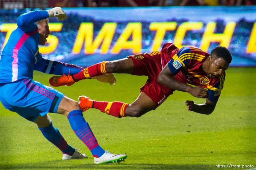 Trent Nelson | The Salt Lake Tribune Real Salt Lake's Robbie Findley (10) collides with Vancouver's David Ousted (1) as Real Salt Lake hosts Vancouver Whitecaps FC at Rio Tinto Stadium in Sandy, Saturday July 19, 2014.