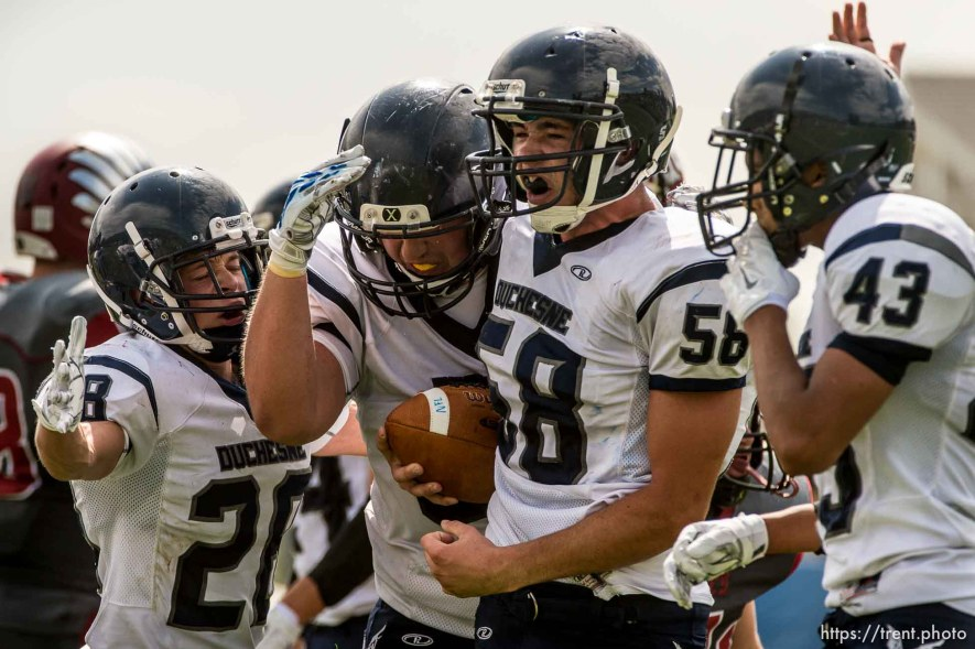 Trent Nelson | The Salt Lake Tribune Duchesne's Jacob Plummer (58) celebrates a turnover as Layton Christian hosts Duchesne, high school football in Layton Thursday August 21, 2014.