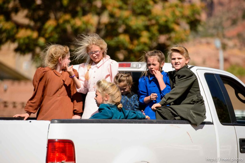Trent Nelson | The Salt Lake Tribune girls in back of truck, in Hildale/Colorado City, Thursday September 25, 2014.