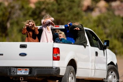 Trent Nelson | The Salt Lake Tribune girls in back of truck in Hildale, Thursday September 25, 2014.