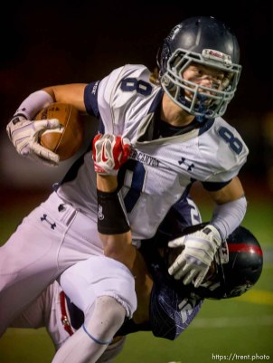Trent Nelson | The Salt Lake Tribune Corner Canyon's Jake Cahoon is brought down by Woods Cross's Keith Saylin as Woods Cross hosts Corner Canyon High School football, in Woods Cross, Wednesday October 15, 2014.