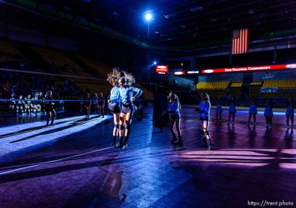 Trent Nelson | The Salt Lake Tribune Piute players leap during player introductions as Panguitch faces Piute High School in the championship match of the State 1A Volleyball Tournament at Utah Valley University in Provo, Saturday November 1, 2014.