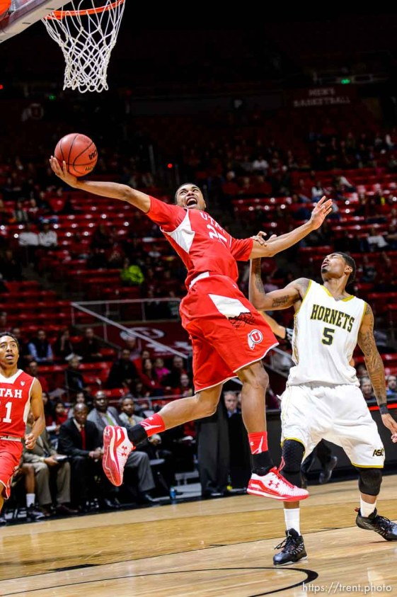 Trent Nelson | The Salt Lake Tribune Utah Utes guard Kenneth Ogbe (25) sinks an incredible shot as he's fouled by Alabama State Hornets guard Bobby Brown (5). University of Utah Utes host the Alabama State Hornets, college basketball at the Huntsman Center in Salt Lake City, Saturday November 29, 2014.