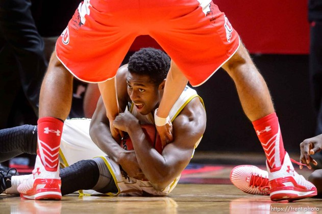Trent Nelson | The Salt Lake Tribune Alabama State Hornets guard Jamel Waters (12) holds onto the ball while Utah Utes forward Chris Reyes (20) reaches in, as the University of Utah Utes host the Alabama State Hornets, college basketball at the Huntsman Center in Salt Lake City, Saturday November 29, 2014.