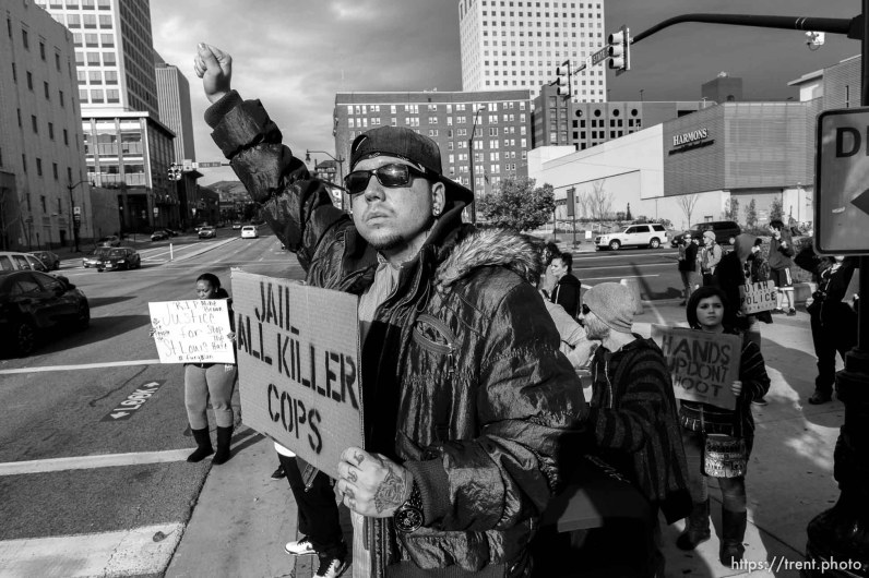 Trent Nelson | The Salt Lake Tribune Protesters gather in front of the Federal Building as approximately 200 people turned out for a rally to protest police brutality in Salt Lake City, Saturday November 29, 2014.