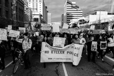 Trent Nelson | The Salt Lake Tribune Protesters march down State Street as approximately 200 people turned out for a rally to protest police brutality in Salt Lake City, Saturday November 29, 2014.