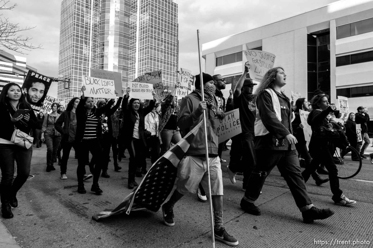 Trent Nelson | The Salt Lake Tribune Protesters march down State Street as approximately 350 people turned out for a rally to protest police brutality in Salt Lake City, Saturday November 29, 2014.