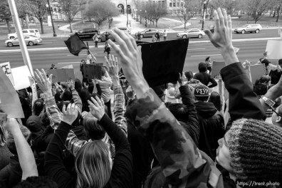 Trent Nelson | The Salt Lake Tribune Protesters hold their hands over their heads in front of the Matheson Courthouse as approximately 350 people turned out for a rally to protest police brutality in Salt Lake City, Saturday November 29, 2014.