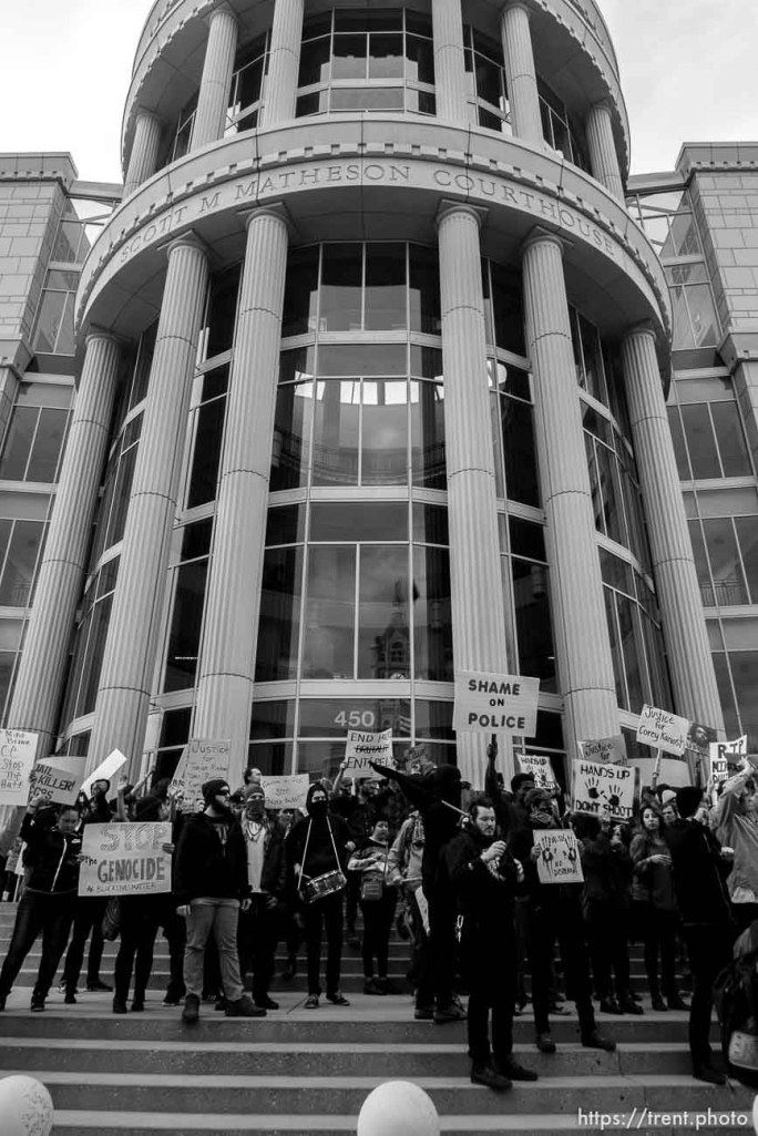Trent Nelson | The Salt Lake Tribune Protesters gather in front of the Matheson Courthouse as approximately 200 people turned out for a rally to protest police brutality in Salt Lake City, Saturday November 29, 2014.