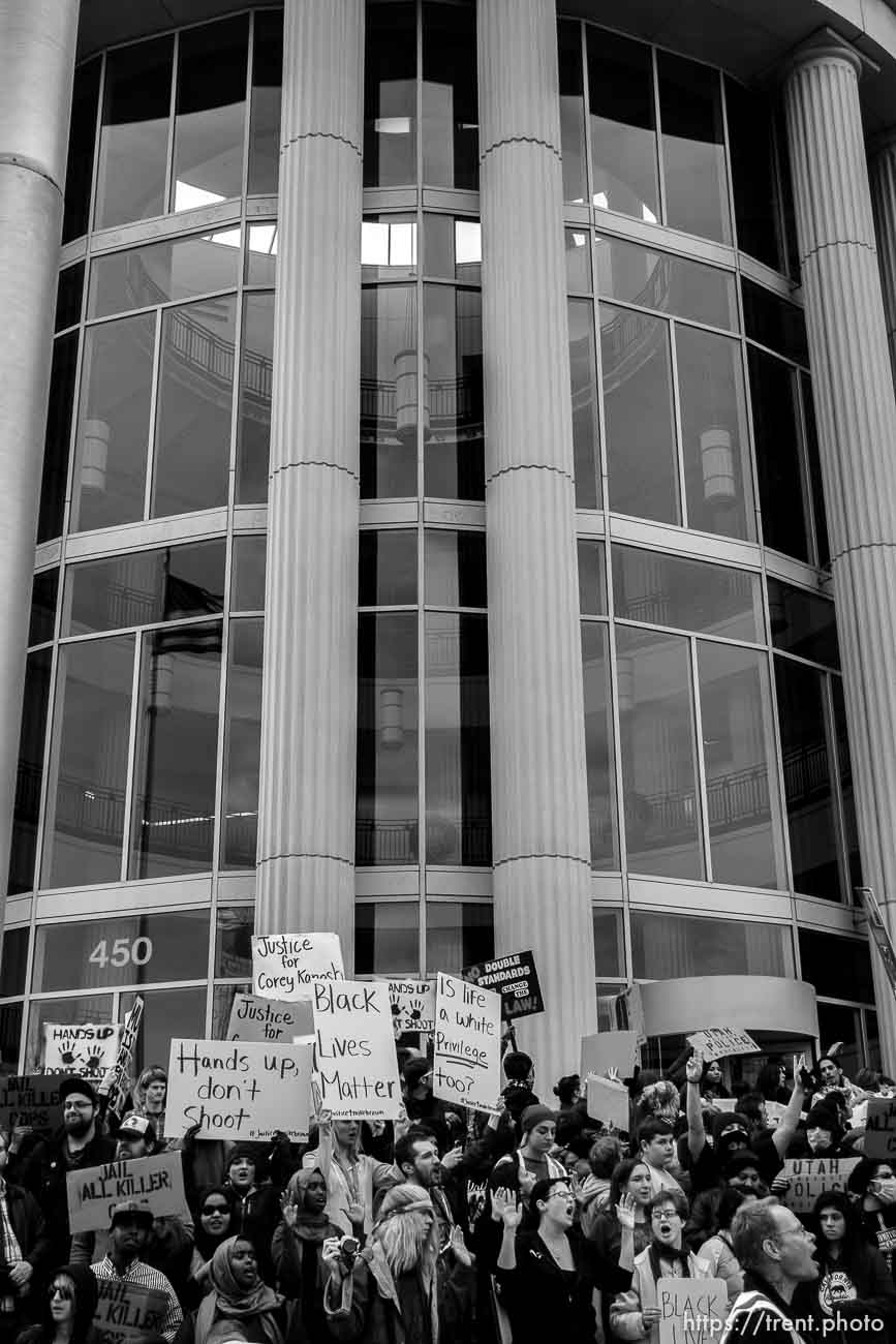 Trent Nelson | The Salt Lake Tribune Protesters gather in front of the Matheson Courthouse as approximately 350 people turned out for a rally to protest police brutality in Salt Lake City, Saturday November 29, 2014.
