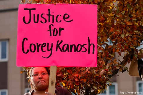 Trent Nelson | The Salt Lake Tribune Ernestine Kanosh holds a sign calling for justice in the Corey Kanosh case, as approximately 350 people turned out for a rally to protest police brutality in Salt Lake City, Saturday November 29, 2014.