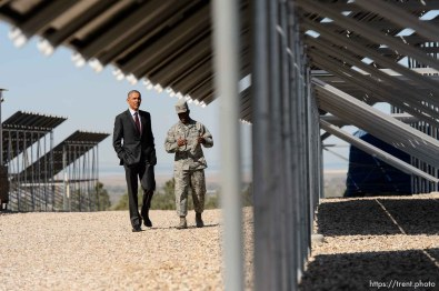 Trent Nelson | The Salt Lake Tribune President Barack Obama speaks to Commander Col Ronald Jolly while touring a solar array at Hill Air Force Base, Friday April 3, 2015.