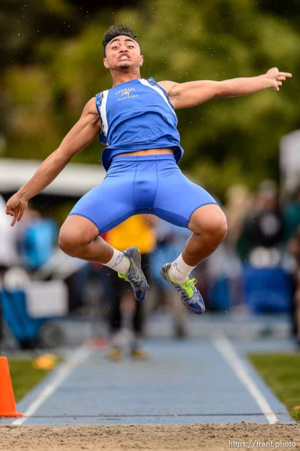 Trent Nelson | The Salt Lake Tribune Cyprus's AJ Semeatu competes in the 4A long jump at the state high school track meet in Provo, Saturday May 16, 2015.