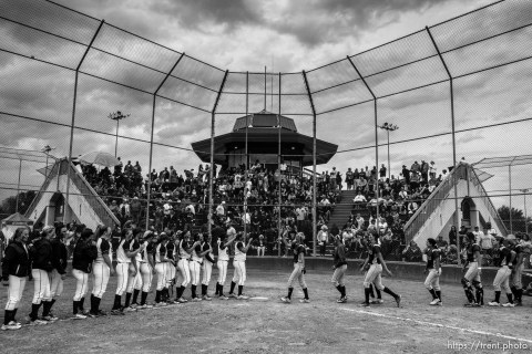 Trent Nelson | The Salt Lake Tribune The Herriman and Copper Hills High School softball teams meet at home plate following Herriman's win, in West Valley City, Thursday May 21, 2015.