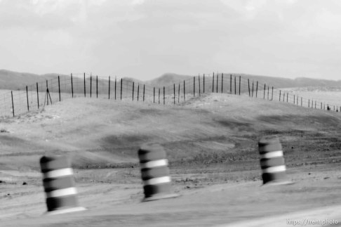 fence. driving from green river to price, Monday May 25, 2015.