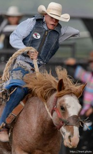 Trent Nelson | The Salt Lake Tribune Nathan Urie competes in Saddle Bronc at the Utah High School Rodeo Association state championships in Heber, Saturday June 6, 2015.