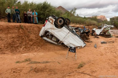 Trent Nelson | The Salt Lake Tribune People at the spot in a Hildale wash Tuesday September 15, 2015 where two vehicles ended up after being washed away in a flash flood. Nine people died (with four still missing) when the SUV and van were washed off a road during a flash flood in this polygamous Utah-Arizona border community.