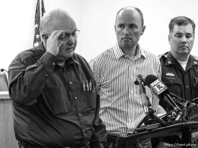 Trent Nelson | The Salt Lake Tribune Hildale Mayor Philip Barlow, left, speaks with Utah Lt. Governor Spencer Cox at right, after nine people were killed and five remained missing Tuesday morning, the day after an SUV and a van were washed off a road during a flash flood in this polygamous Utah-Arizona border community.