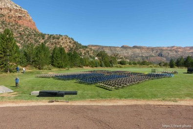 Trent Nelson | The Salt Lake Tribune chairs set out for a memorial for the 13 (and 1 still missing) victims of a September 14th flash flood. The memorial was held in Maxwell Park in Hildale, Friday September 25, 2015.