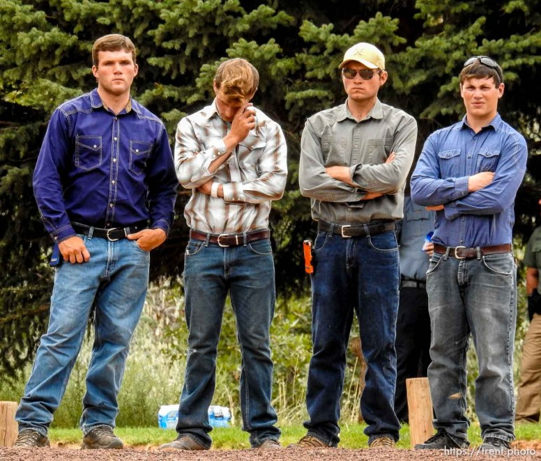 Trent Nelson | The Salt Lake Tribune Young men look on at a memorial for the 13 (and 1 still missing) victims of a September 14th flash flood. The memorial was held in Maxwell Park in Hildale, Saturday September 26, 2015.